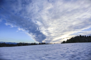 Winter Scene: Stratus clouds at sunset in the Bavarian Highlands